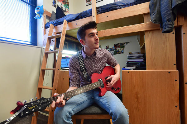 A Student Playing Guitar in the Residence Hall