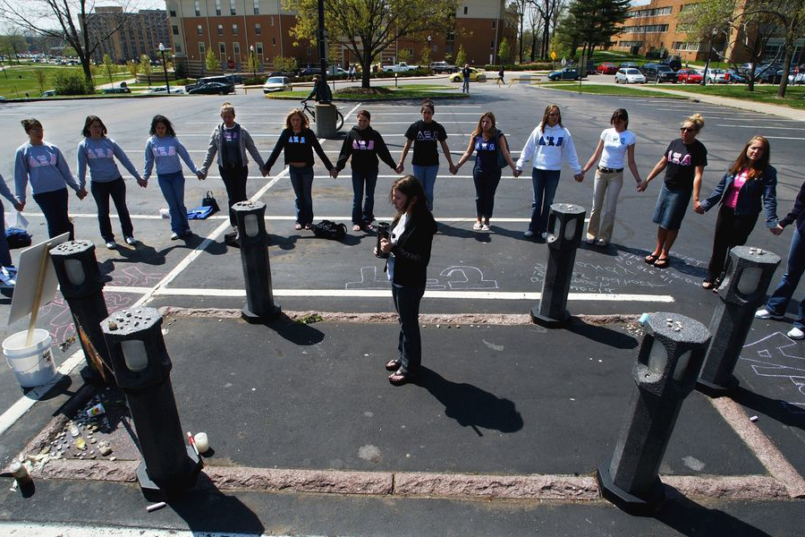 Kent State University students stand vigil where one of four slain Kent State students was shot on May 4, 1970.