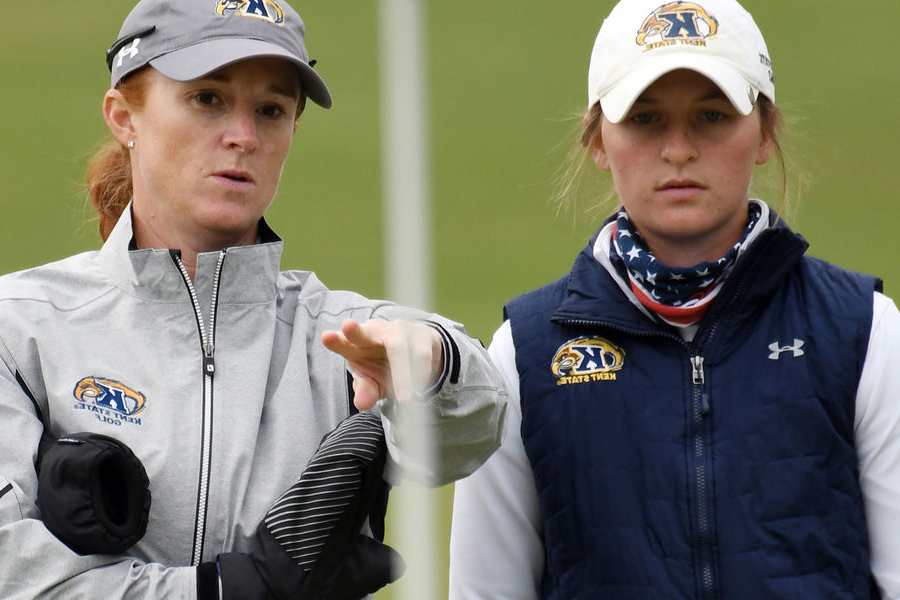 Lisa Strong (right) helps Kory Nielsen visualize a putt during 2019 Fall golf season