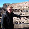 Student posing in front of the colosseum